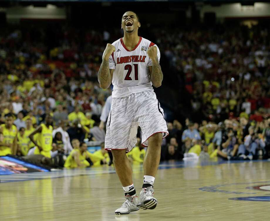 Louisville 82, Michigan 76Road to Atlanta: Look back at the full March Madness bracketLive updates:Follow all the Final Four actionLouisville forward Chane Behanan (21) reacts after defeating Michigan after the second half of the NCAA Final Four tournament college basketball championship game Monday, April 8, 2013, in Atlanta. Louisville won 82-76. (AP Photo/David J. Phillip) Photo: David J. Phillip, Associated Press / AP