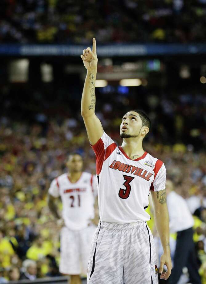 Louisville 82, Michigan 76Road to Atlanta: Look back at the full March Madness bracketLive updates:Follow all the Final Four actionLouisville's Peyton Siva (3) gestures against the Louisville during the second half of the NCAA Final Four tournament college basketball championship game Monday, April 8, 2013, in Atlanta. (AP Photo/John Bazemore) Photo: John Bazemore, Associated Press / AP