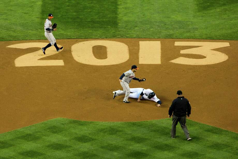 Michael Saunders, of the Seattle Mariners, safely slides into second base during the first inning of the Seattle Mariners home opener against the Houston Astros. Photo: JORDAN STEAD / SEATTLEPI.COM
