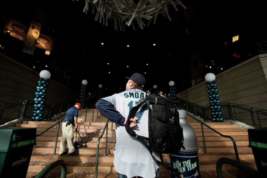 Sporting a jersey, Joel Firman, 20, center, enters Safeco Field via the home plate entrance for the Seattle Mariners home opener. Photo: JORDAN STEAD / SEATTLEPI.COM