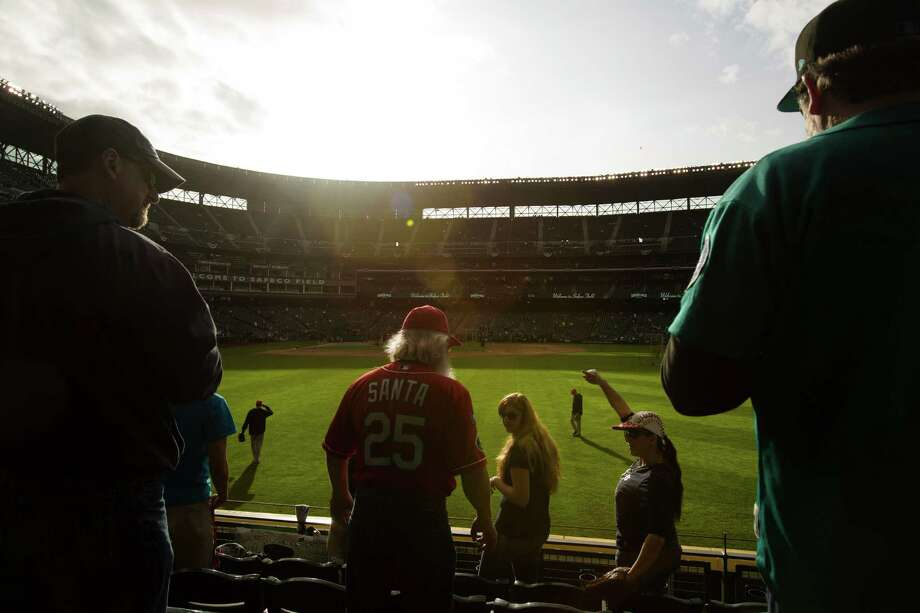 Mariners fans wait in the outfield to catch stray balls during warm up before the Seattle Mariners opening home game against the Houston Astros. Photo: JORDAN STEAD / SEATTLEPI.COM