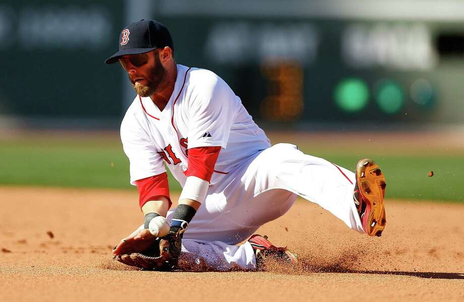 Dustin Pedroia goes low to field a ground ball during Boston's win at Fenway Park. Photo: Jared Wickerham / Getty Images