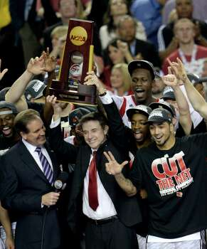 Louisville 82, Michigan 76Road to Atlanta: Look back at the full March Madness bracketLive updates: Follow all the Final Four actionLouisville Cardinals head coach Rick Pitino hoists the trophy after defeating Michigan 82-76 in the NCAA Men's Basketball Championship at the Georgia Dome in Atlanta, Georiga, Monday, April 8, 2013. (Drew Tarter/MCT) Photo: Drew Tarter, McClatchy-Tribune News Service / MCT