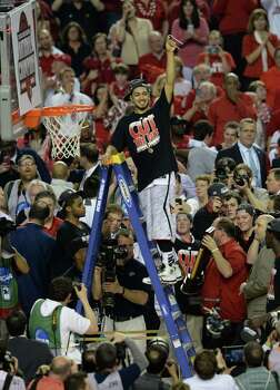 Louisville 82, Michigan 76Road to Atlanta: Look back at the full March Madness bracketLive updates: Follow all the Final Four actionPeyton Siva (3) of the Louisville Cardinals celebrates as he cuts the net after defeating Michigan 82-78 in the NCAA Men's Basketball Championship at the Georgia Dome in Atlanta, Georiga, Monday, April 8, 2013. (Drew Tarter/MCT) Photo: Drew Tarter, McClatchy-Tribune News Service / MCT