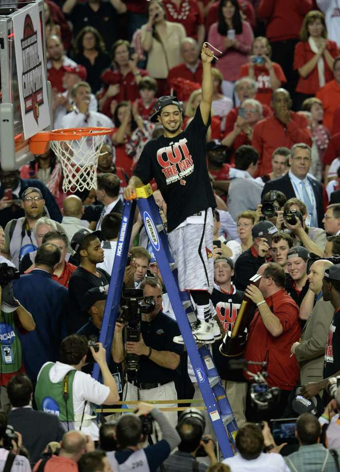 Louisville 82, Michigan 76Road to Atlanta: Look back at the full March Madness bracketLive updates:Follow all the Final Four actionPeyton Siva (3) of the Louisville Cardinals celebrates as he cuts the net after defeating Michigan 82-78 in the NCAA Men's Basketball Championship at the Georgia Dome in Atlanta, Georiga, Monday, April 8, 2013. (Drew Tarter/MCT) Photo: Drew Tarter, McClatchy-Tribune News Service / MCT