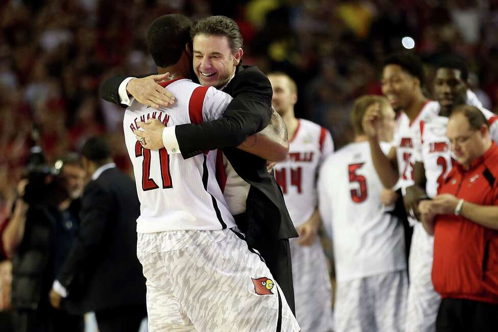 ATLANTA, GA - APRIL 08: (L-R) Chane Behanan #21 and head coach Rick Pitino of the Louisville Cardinals celebrate after they won 82-76 against the Michigan Wolverines during the 2013 NCAA Men's Final Four Championship at the Georgia Dome on April 8, 2013 in Atlanta, Georgia. (Photo by Andy Lyons/Getty Images)