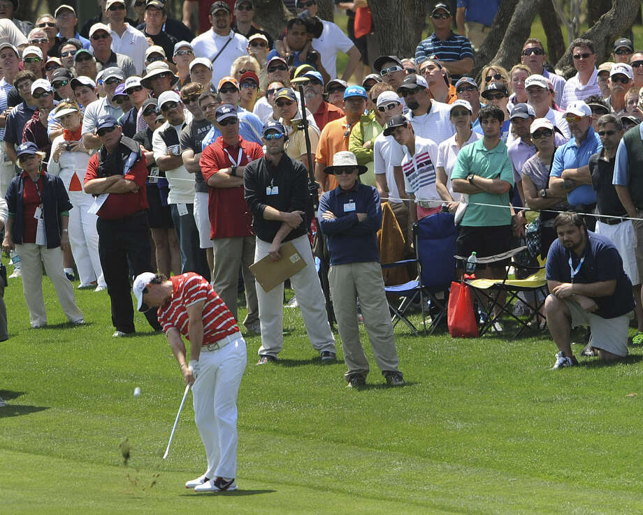 Large galleries of fans, such as the group pictured following Rory McIlroy down the ninth fairway during Saturday's third round, were more commonplace at this year's Valero Texas Open. Photo: Billy Calzada / San Antonio Express-News