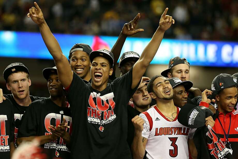 ATLANTA, GA - APRIL 08:  Peyton Siva #3 of the Louisville Cardinals celebrate with teammates after they won 82-76 against the Michigan Wolverines during the 2013 NCAA Men's Final Four Championship at the Georgia Dome on April 8, 2013 in Atlanta, Georgia.  (Photo by Andy Lyons/Getty Images) Photo: Andy Lyons, Getty Images