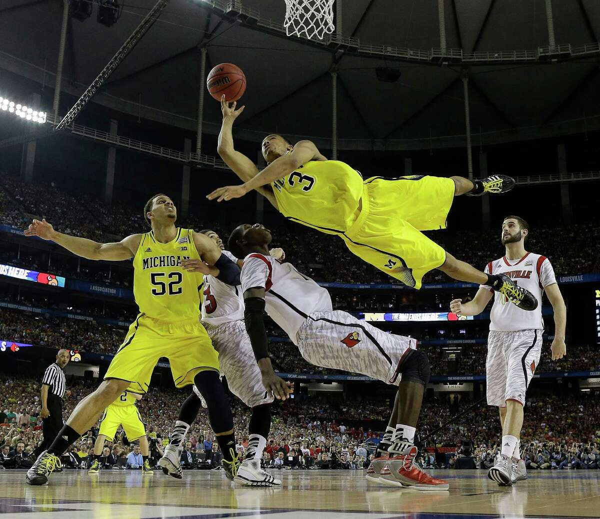 """Guard Trey Burke (3) led Michigan with 24 points, but the Wolverines ran out of steam down the stretch against a relentless Louisville team that coach Rick Pitino called """"the 13 toughest guys I've ever coached."""""""