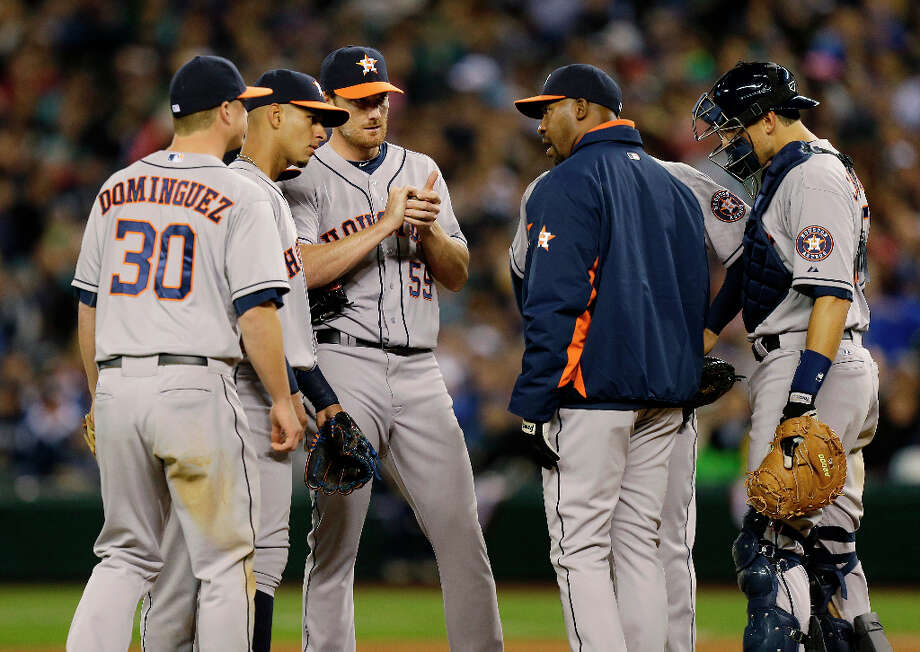 April 8: Mariners 3, Astros 0 Astros manager Bo Porter, second from right, goes to the mound to talk to Astros starting pitcher Philip Humber, third from left, during the fifth inning. Photo: Ted S. Warren, Associated Press / AP