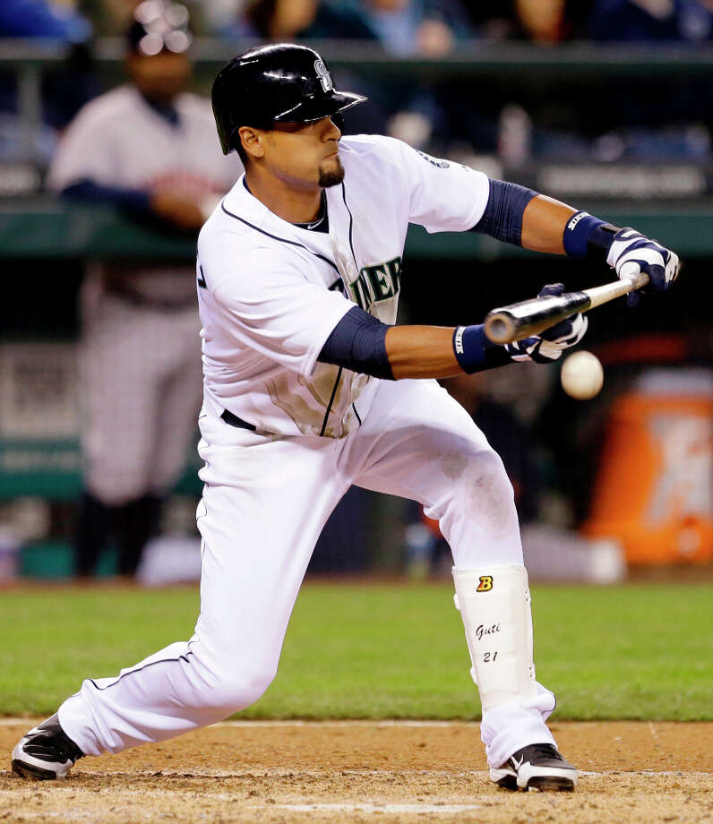 Franklin Gutierrez bunts in a run against the Astros in the fifth inning. Photo: Elaine Thompson, Associated Press / AP