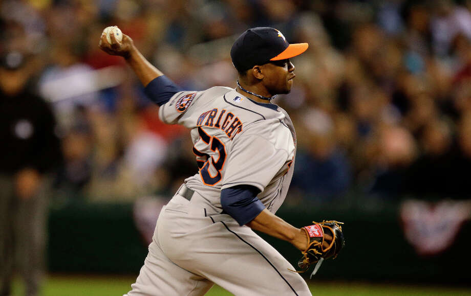 Astros relief pitcher Wesley Wright pitches against the Mariners in the seventh inning. Photo: Ted S. Warren, Associated Press
