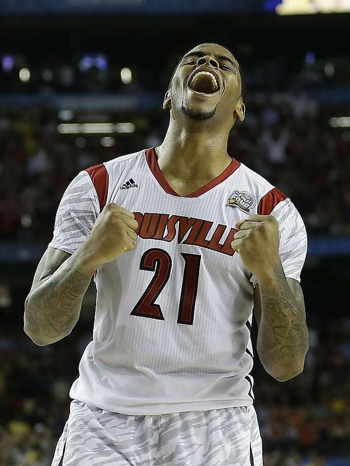 Louisville forward Chane Behanan (21) reacts after defeating Michigan after the second half of the NCAA Final Four tournament college basketball championship game Monday, April 8, 2013, in Atlanta. Louisville won 82-76. (AP Photo/David J. Phillip) Photo: David J. Phillip, Associated Press