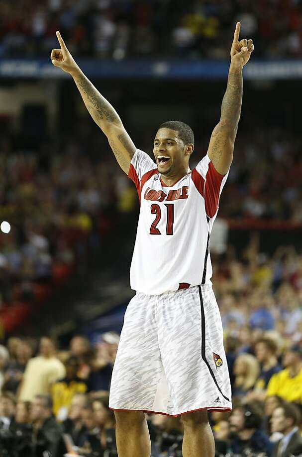 Chane Behanan (21) of the Louisville Cardinals celebrates at the end of an 82-76 victory over Michigan in the NCAA Men's Basketball Championship at the Georgia Dome in Atlanta, Georgia, Monday, April 8, 2013. (Mark Cornelison/Lexington Herald-Leader/MCT) Photo: Mark Cornelison, McClatchy-Tribune News Service