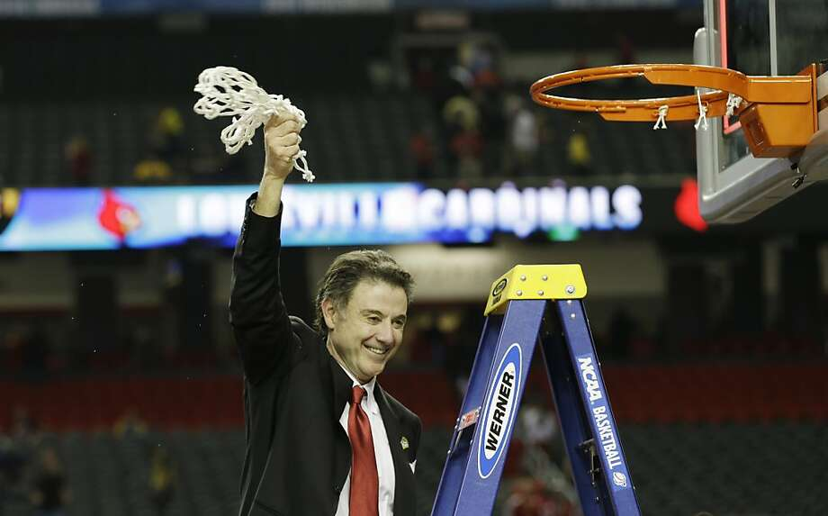 Louisville  head coach Rick Pitino cuts the net after his team beat Michigan 82-76 at the NCAA Final Four tournament college basketball championship game Monday, April 8, 2013, in Atlanta.  (AP Photo/David J. Phillip) Photo: David J. Phillip, Associated Press