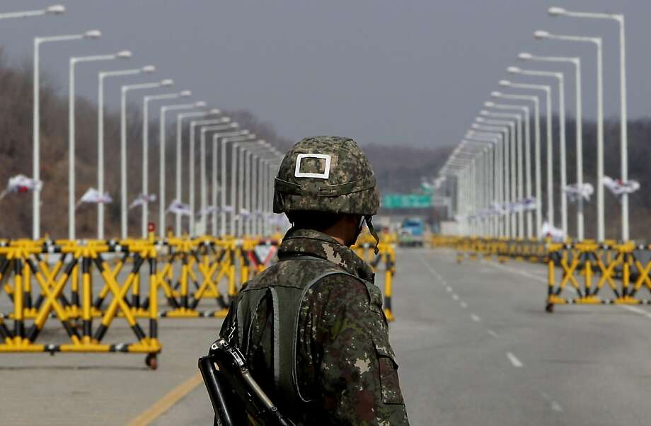 PAJU, SOUTH KOREA - APRIL 09:  A South Korean soldier stands at a military check point connecting South and North Korea at the Unification Bridge on April 9, 2013 in Paju, South Korea. North Korea announced it will withdraw all workers from Kaesong joint industrial complex, five days after unilaterally banning South Korean workers re-entry to Kaesong.  (Photo by Chung Sung-Jun/Getty Images) ***BESTPIX*** Photo: Chung Sung-Jun, Getty Images