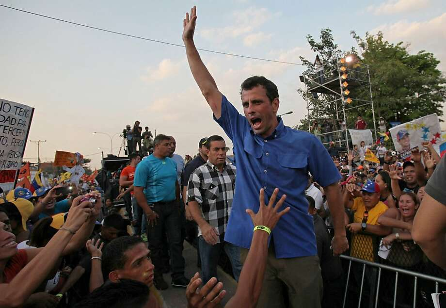 Opposition presidential candidate Henrique Capriles greets supporters during a campaign rally  in Puerto La Cruz, Venezuela, Monday, April 8, 2013. Capriles is running against ruling party candidate Nicolas Maduro in next weekend's presidential election.(AP Photo/Fernando Llano) Photo: Fernando Llano, Associated Press