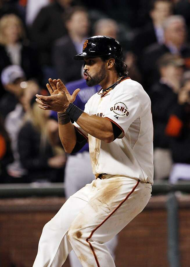 Angel Pagan celebrates scoring on a Buster Posey rbi single in the eighth inning . The San Francisco Giants played the Colorado Rockies  at AT&T Park in San Francisco on Monday, April 8, 2013, and won 4-2. Photo: Carlos Avila Gonzalez, The Chronicle