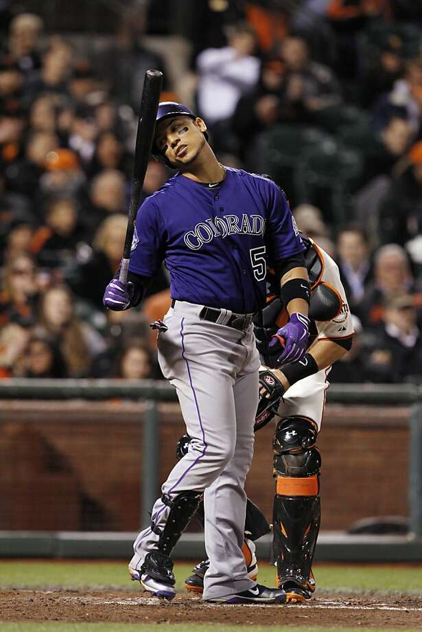 Carlos Gonzalez of the Colorado Rockies reacts after striking out in the eighth inning. The San Francisco Giants played the Colorado Rockies  at AT&T Park in San Francisco on Monday, April 8, 2013, and won 4-2. Photo: Carlos Avila Gonzalez, The Chronicle