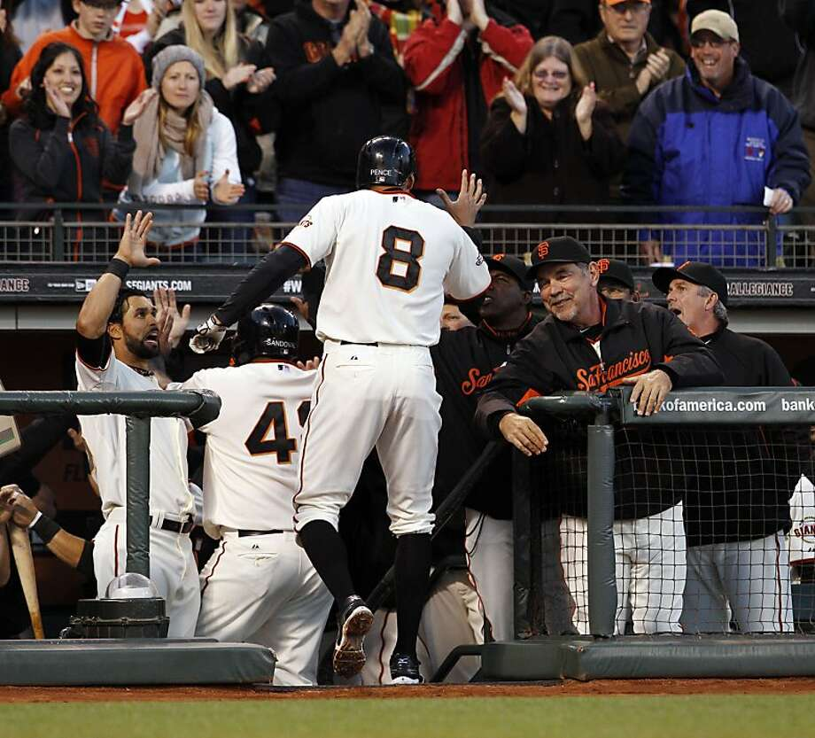 Hunter Pence is greeted at the dugout after hitting his three-run homerun in the first inning. The San Francisco Giants played the Colorado Rockies  at AT&T Park in San Francisco on Monday, April 8, 2013, and won 4-2. Photo: Carlos Avila Gonzalez, The Chronicle