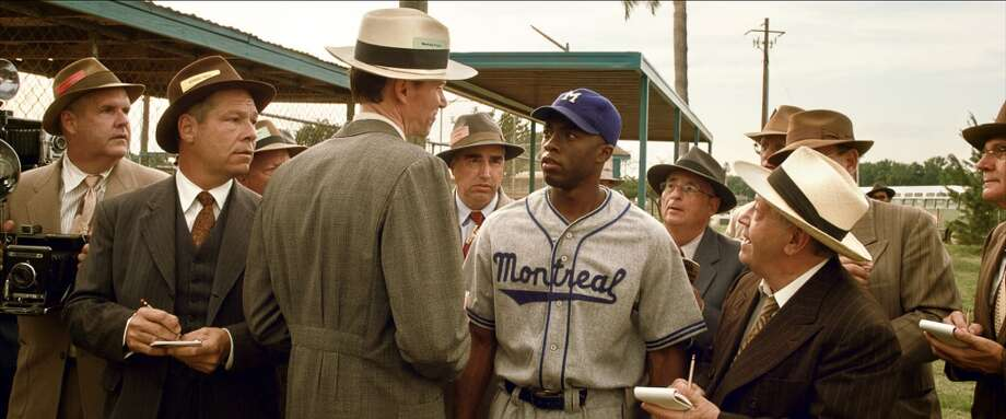 Actor Chadwick Boseman (right center), as Jackie Robinson, is seen in the movie \'\'42\'\' wearing a Montreal Royals uniform produced by Seattle\'s Ebbets Field Flannels.