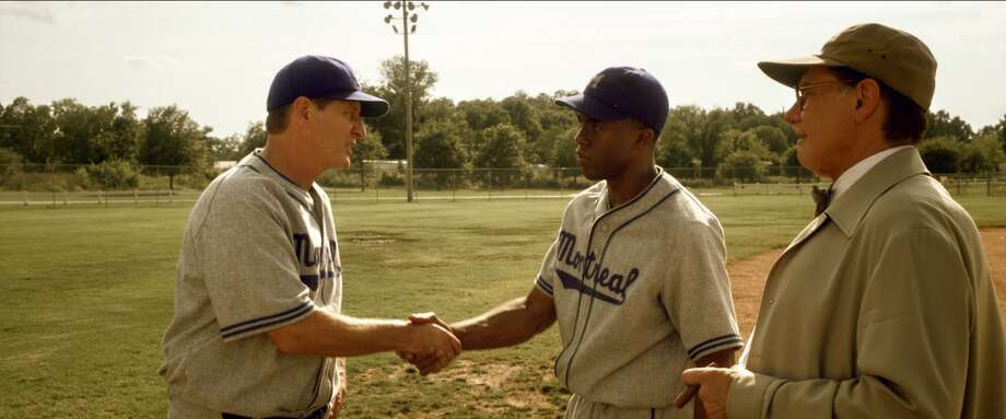 Actors Brett Cullen (left), as Clay Hopper, and Chadwick Boseman, as Jackie Robinson, are seen in the movie \'\'42\'\' wearing Montreal Royals uniforms produced by Seattle\'s Ebbets Field Flannels.