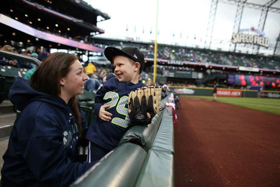 London Finck, 5, checks out the field during his first baseball game with his mom Rikki Finck. Photo: JOSHUA TRUJILLO / SEATTLEPI.COM