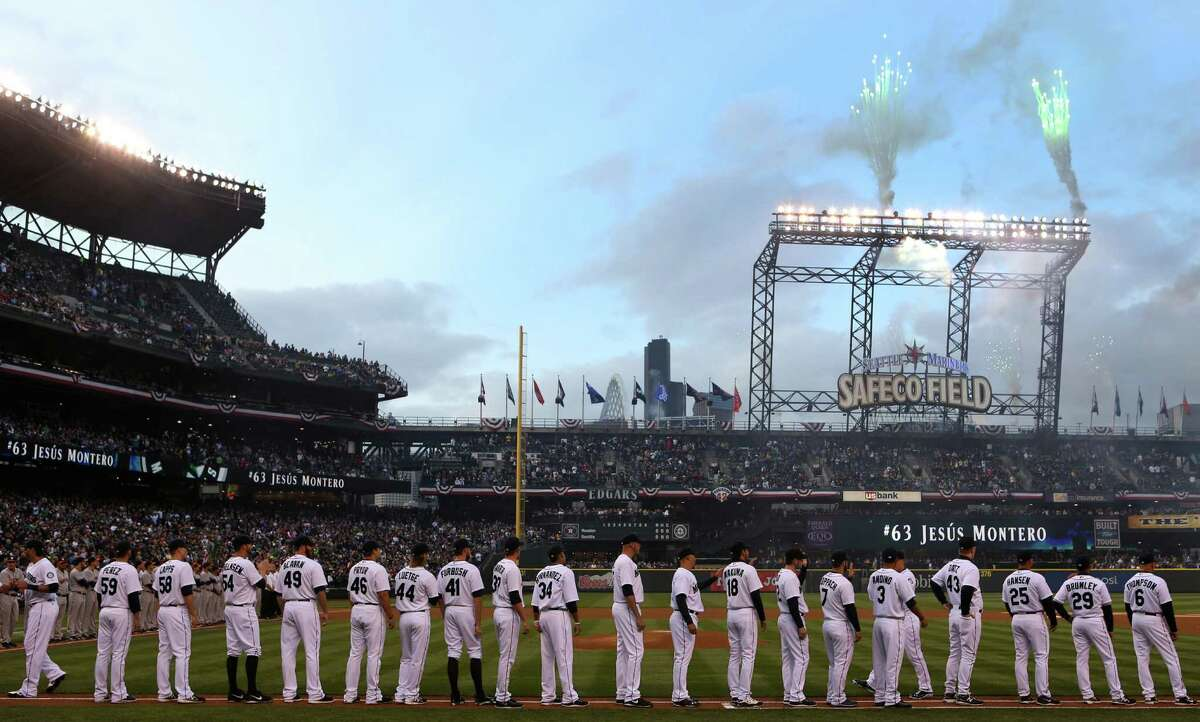 Seattle Mariners players are introduced during opening day ceremonies.