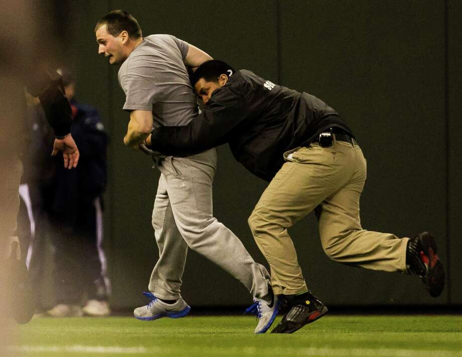 Security tackled a man who ran onto the field during the game. Photo: JORDAN STEAD / SEATTLEPI.COM