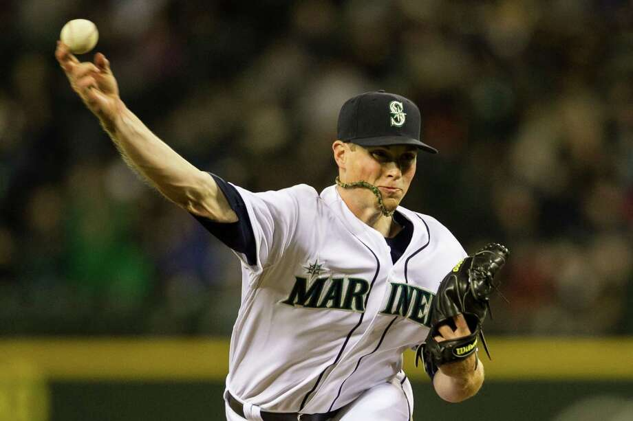 Seattle Mariners pitcher Carter Capps burns one down the middle during the opening home game. Photo: JORDAN STEAD / SEATTLEPI.COM