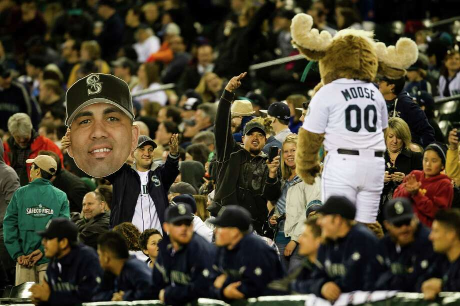 Fans goof around with the Mariner Moose. Photo: JORDAN STEAD / SEATTLEPI.COM