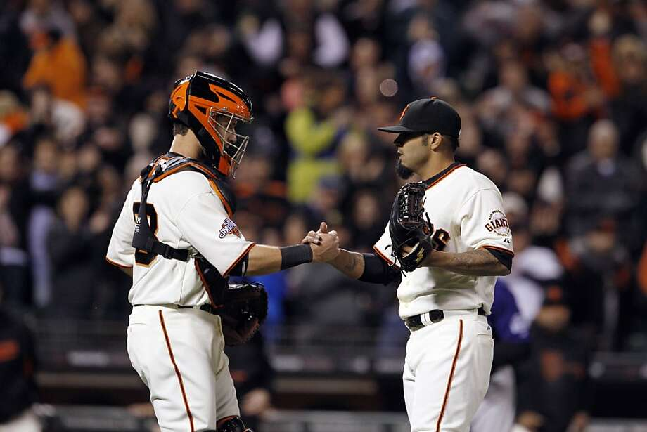 Sergio Romo, right, and Buster Posey, left, celebrate after the victory. The San Francisco Giants played the Colorado Rockies  at AT&T Park in San Francisco on Monday, April 8, 2013, and won 4-2. Photo: Carlos Avila Gonzalez, The Chronicle