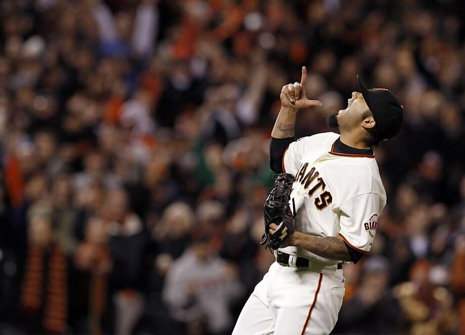 Sergio Romo celebrates after the Giants defeated the Rockies on Monday. The San Francisco Giants played the Colorado Rockies  at AT&T Park in San Francisco on Monday, April 8, 2013, and won 4-2. Photo: Carlos Avila Gonzalez, The Chronicle
