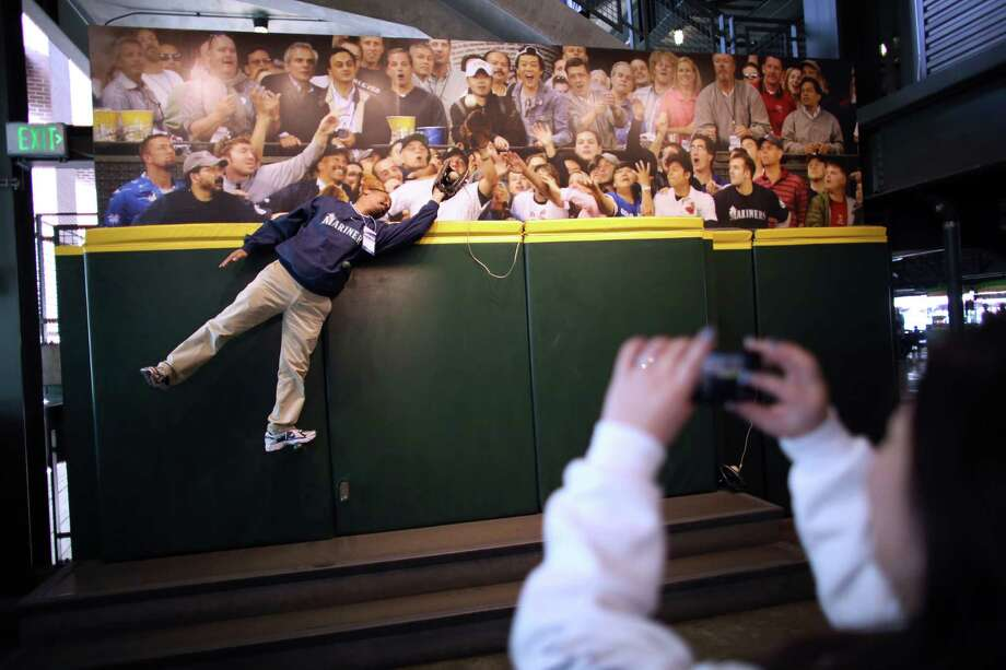 Terry Smith poses for a photo at a replica of an outfield wall at Safeco Field. Photo: JOSHUA TRUJILLO / SEATTLEPI.COM