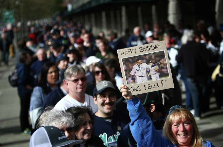 A fan holds up a sign wishing Felix Hernandez a happy birthday. Photo: JOSHUA TRUJILLO / SEATTLEPI.COM