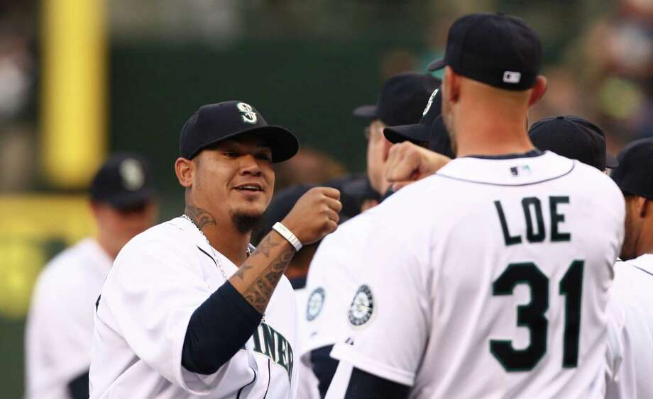 Pitcher Felix Hernandez greets teammates during opening day. Photo: JOSHUA TRUJILLO / SEATTLEPI.COM