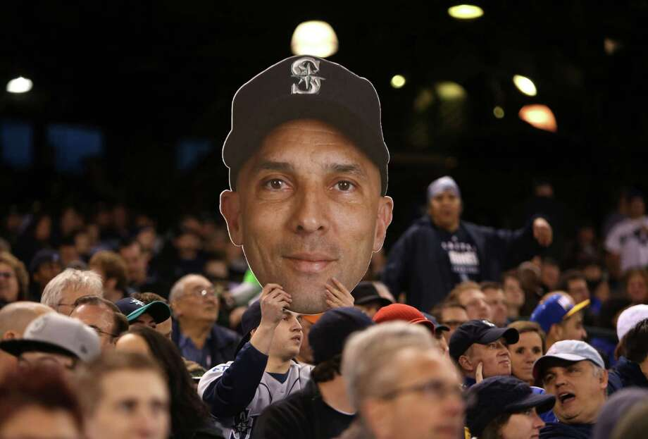 A fan holds up an image of Raul Ibanez. Photo: JOSHUA TRUJILLO / SEATTLEPI.COM