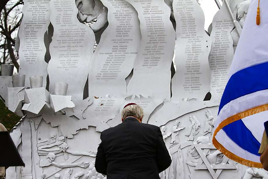 Rabbi Alan Londy of the New Reform Temple of Kansas City, Mo., paused for a moment in front of the memorial to the six million during a Holocaust Memorial Service Sunday, April 7, 2013 at the Jewish Community Campus in Overland Park, Kan. The service commemorates the 70th anniversary of the Warsaw ghetto uprising. It also marked the 50th anniversary of the dedication of the memorial to the six million. Photo: Todd Feeback/The Kansas City Sta, Associated Press