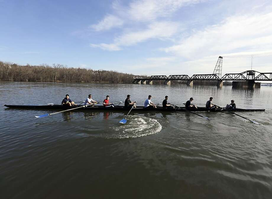 Members of the Shaker High School boys' crew team take off for practice on the Hudson River on a warm spring day on Monday, April 8, 2013, in Albany, N.Y. (AP Photo/Mike Groll) Photo: Mike Groll, Associated Press