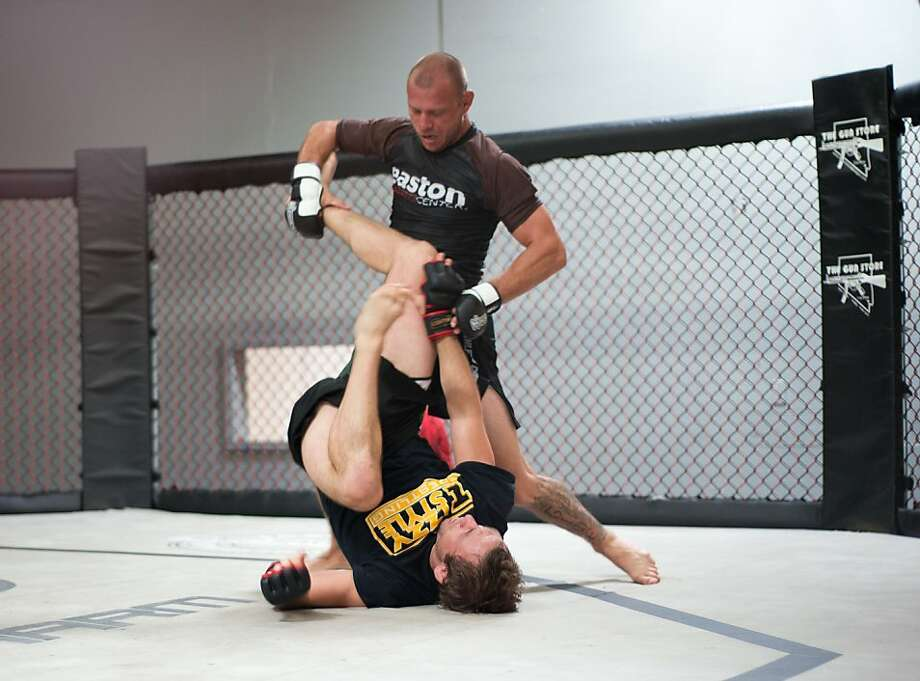 "ALBUQUERQUE, NM - APRIL 8:  UFC lightweight contender Donald ""Cowboy"" Cerrone (top) spars during a media event at Jackson's Mixed Martial Arts & Fitness Academy on APRIL 8, 2013 in Albuquerque, New Mexico. (Photo by Steve Snowden/Getty Images) Photo: Steve Snowden, Getty Images"