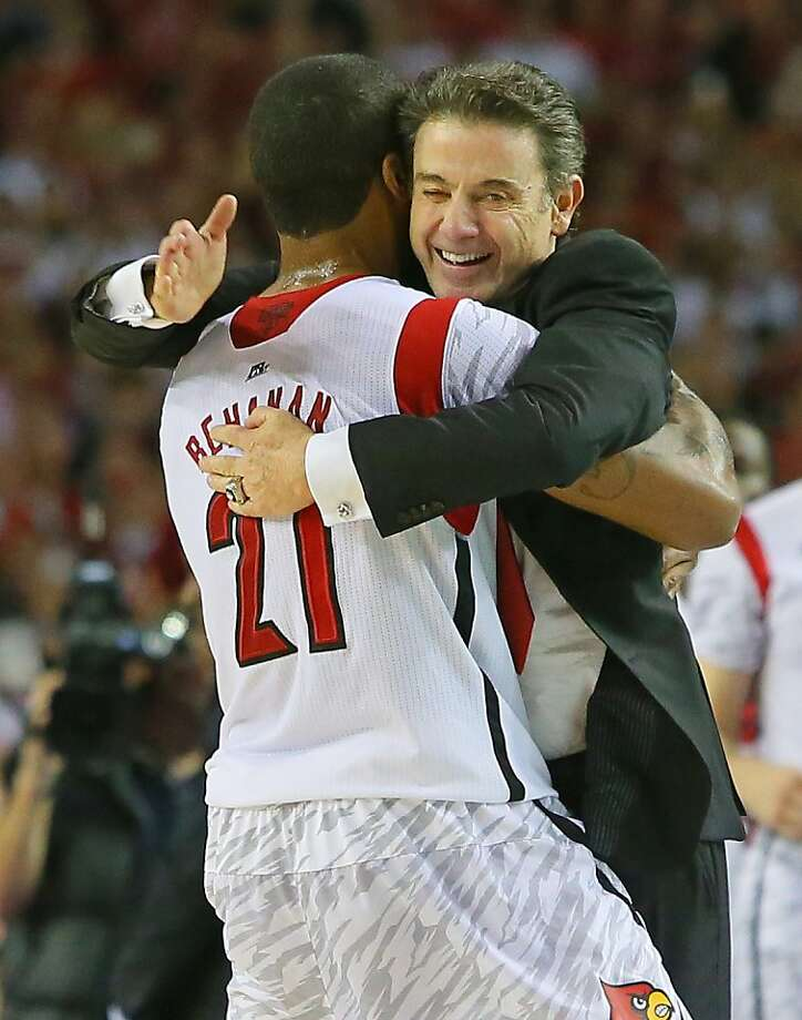 Louisville forward Chane Behanan embraces head coach Rick Pitino who gives him a pat on the back after defeating Michigan to win the NCAA Division I National Championship on Monday, April 8, 2013, in Atlanta. Louisville beat Michigan 82-76 for NCAA title. (AP Photo/Atlanta Journal Constitution, Curtis Compton) Photo: Curtis Compton, Associated Press