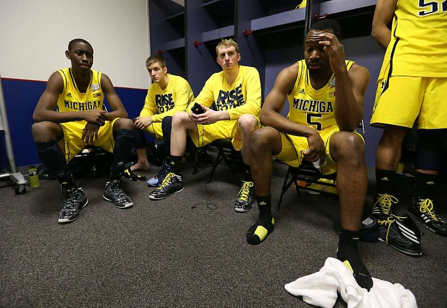 ATLANTA, GA - APRIL 08:  Caris LeVert #23, Max Bielfeldt #44, Blake McLimans #22  and Eso Akunne #5 of the Michigan Wolverines sit in the locker room dejected after they lost 82-76 against the Louisville Cardinals during the 2013 NCAA Men's Final Four Championship at the Georgia Dome on April 8, 2013 in Atlanta, Georgia.  (Photo by Streeter Lecka/Getty Images) Photo: Streeter Lecka, Getty Images