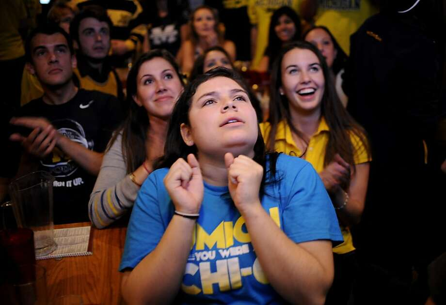 Michigan  student Haley Schreier, center, watches  as University of Michigan has possession of the ball while watching the first half of the NCAA championship game  at Good Time Charley's in Ann Arbor, Monday April 8, 2013. Louisville beat Michigan 82-76. (AP Photo/The Detroit News, Elizabeth Conley) Photo: Elizabeth Conley, Associated Press