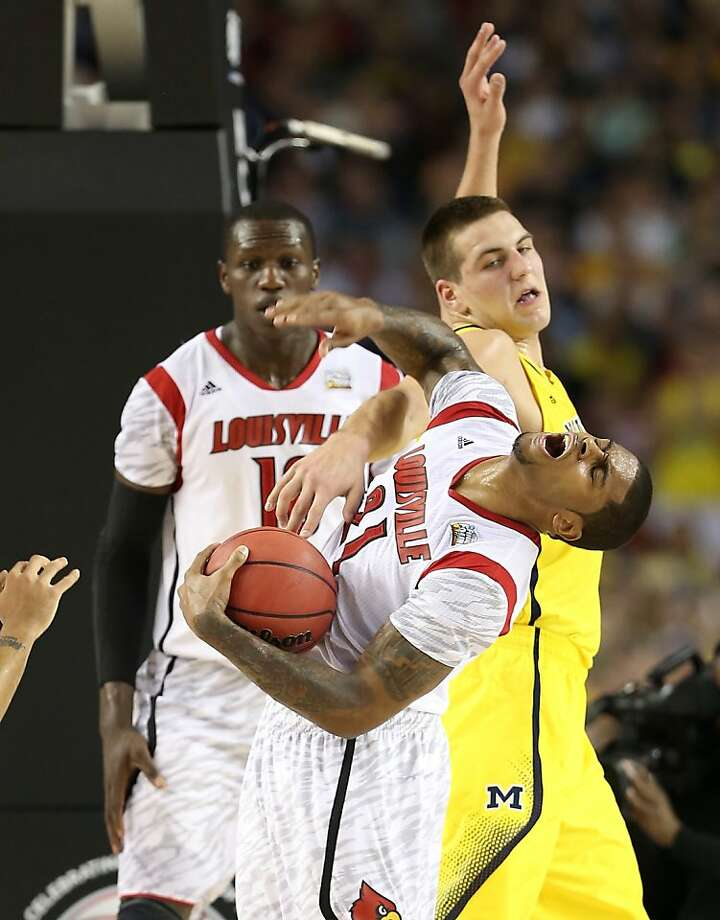 ATLANTA, GA - APRIL 08:  Chane Behanan #21 of the Louisville Cardinals draws contact in the first half against Mitch McGary #4 of the Michigan Wolverines during the 2013 NCAA Men's Final Four Championship at the Georgia Dome on April 8, 2013 in Atlanta, Georgia.  (Photo by Andy Lyons/Getty Images) Photo: Andy Lyons, Getty Images