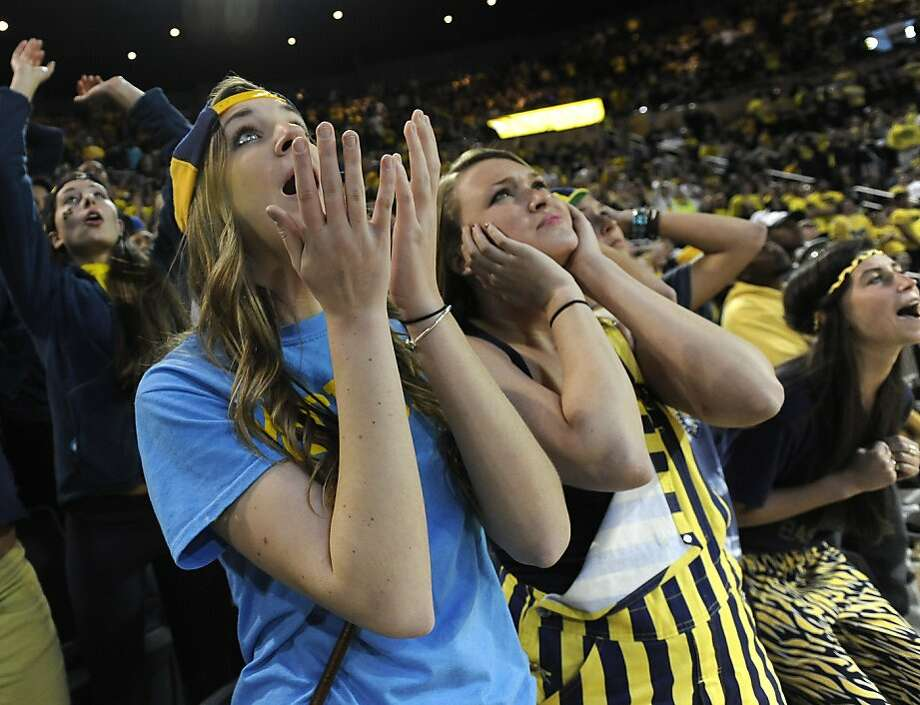 Michigan Juniors Janna Kramer, left, and Anna Paneral watch the final moments of the game at Crisler Arena in Ann Arbor  as Michigan falls to Louisville 82-76 in the NCAA final in Atlanta, Monday April 8, 2013.   (AP Photo/The Detroit News, David Guralnick) Photo: David Guralnick, Associated Press