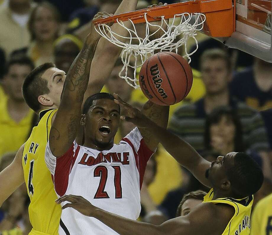 Louisville forward Chane Behanan (21) dunks against the Michigan during the first half of the NCAA Final Four tournament college basketball championship game Monday, April 8, 2013, in Atlanta. (AP Photo/Chris O'Meara) Photo: Chris O'Meara, Associated Press