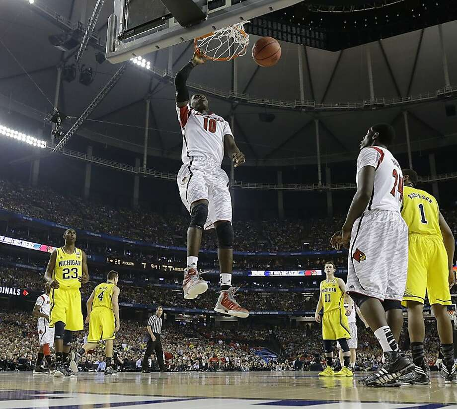 Louisville center Gorgui Dieng (10) shoots against the Michigan during the first half of the NCAA Final Four tournament college basketball championship game Monday, April 8, 2013, in Atlanta. (AP Photo/Charlie Neibergall) Photo: Charlie Neibergall, Associated Press