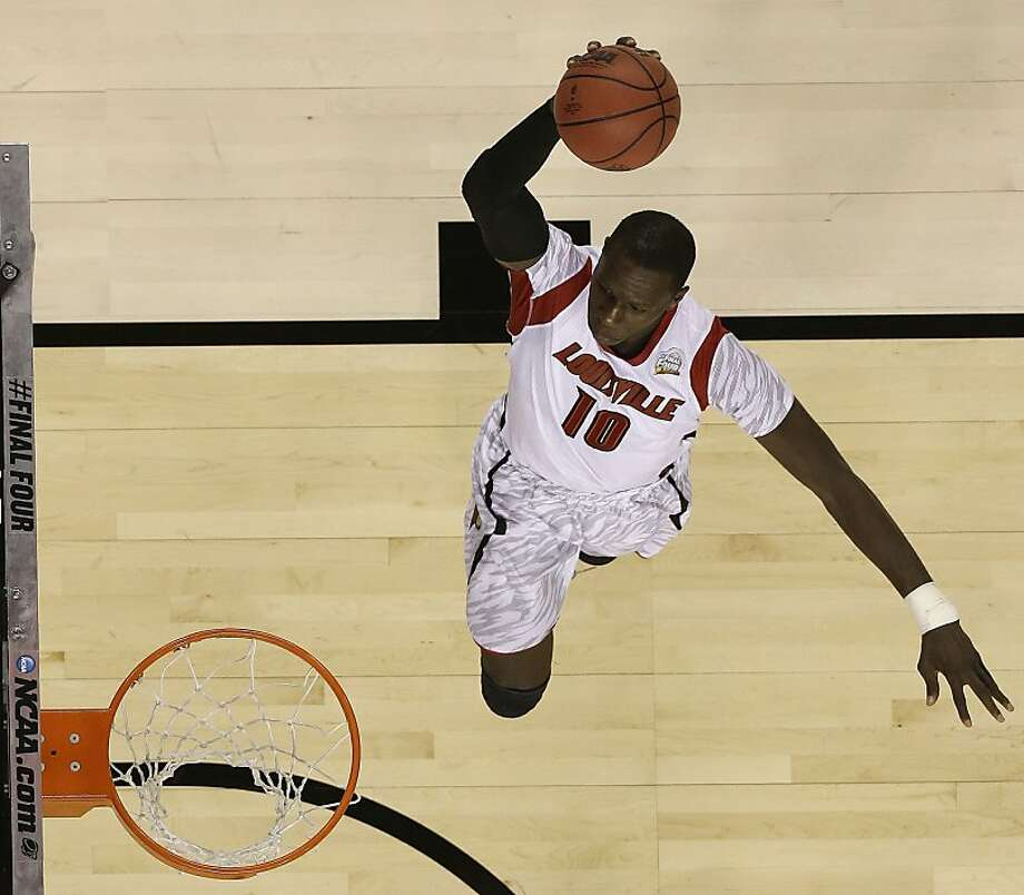 Louisville center Gorgui Dieng (10) heads to the hoop against the Michigan during the first half of the NCAA Final Four tournament college basketball championship game Monday, April 8, 2013, in Atlanta. (AP Photo/Charlie Neibergall) Photo: Charlie Neibergall, Associated Press
