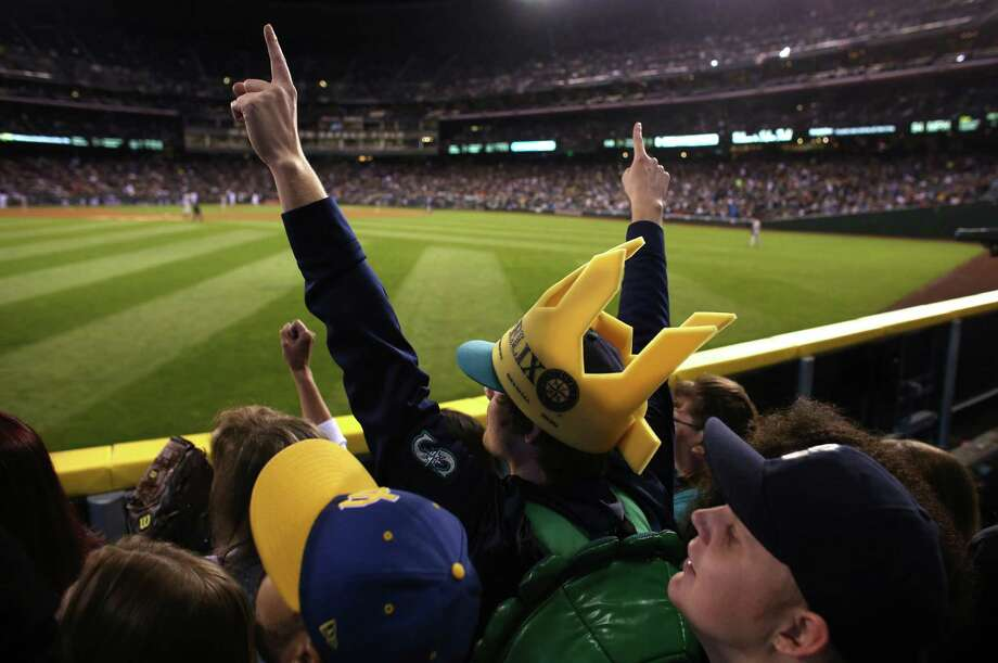 "A fan throws up his arms in ""The Pen.""  Photo: JOSHUA TRUJILLO / SEATTLEPI.COM"