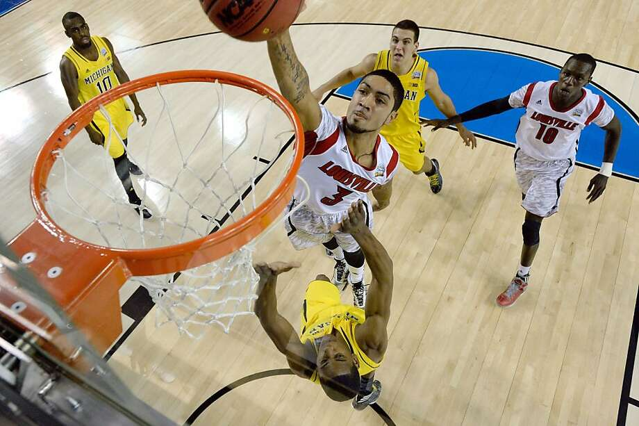ATLANTA, GA - APRIL 08:  Peyton Siva #3 of the Louisville Cardinals attempts a dunk in the first half against Glenn Robinson III #1 of the Michigan Wolverines during the 2013 NCAA Men's Final Four Championship at the Georgia Dome on April 8, 2013 in Atlanta, Georgia.  (Photo by Chris Steppig-Pool/Getty Images) Photo: Pool, Getty Images
